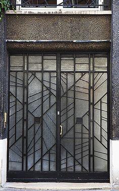 Art Deco door to the artists' studios at 5 Rue du Dr Blanche, designed by Pierre Patout. By Mintball.