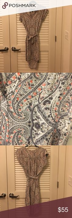 Paisley BCBG dress Multicolor paisley print BCBG dress. Slightly longer in the back and has a matching belt and open v-neck. BCBGMaxAzria Dresses High Low