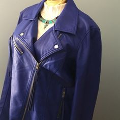 """Royal Blue Faux Leather Jacket with FringeNWT Royal Blue faux leather waist length jacket with fringe along back of sleeves & upper back of jacket. NWT. Length 21"""". Sleeves 25"""" with a zipper@ bottom of sleeve 5 3/4"""". Bust ( across back 21"""" arm pit to arm pit). fits 41"""" bust. Fully lined 100% polyester . Outer shell : Viscose with polyurethane coating. Upper right zip pocket with fringe. I  RONSON Jackets & Coats"""