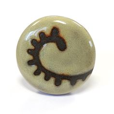 Items similar to Sand Paisley Cabinet Knob on Etsy Cabinet Knobs, Paisley, Unique Jewelry, Handmade Gifts, Etsy, Vintage, Kid Craft Gifts, Craft Gifts, Costume Jewelry