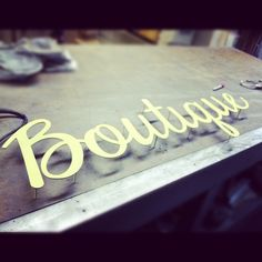 Boutique sign before being painted.