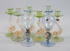 6 Murano glass candlesticks with aldine dolphin bases and gold fleck decoration and a pair of blown bulbous vases with sea dragon bases, Venice, Italy