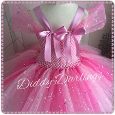 Peppa Pig Tutu Dress. Princess Tutu Dress. Sparkly Peppa Pig Tutu Dress. Beautiful & lovingly handmade.  Price varies on size, starting from £25.  Please message us for more info.  Find us on Facebook www.facebook.com/DiddyDarlings1 or our website www.diddydarlings.co.uk