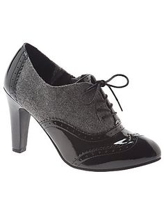 Menswear appeal goes totally feminine in our patent & tweed Oxford heel. Tie-front and top-stitch details keep the look classic, with glossy patent shine for added polish. In wide widths with an elastic side gore for stretch and an easy-entry side zipper.  lanebryant.com