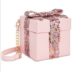 """Cute Cute Cute Betsey Johnson Pink Sequin Purse Cute Cute Cute Betsey Johnson Pink Sequin Gift Box cross-body bag.  From the limited Pink Sequin Collection.  features: magnetic snap closure;  sequin-covered bow with Betsey logo heart on box; detachable strap,  approx. 5 x 5 x 5.25""""; 23"""" drop.   NWT retail price $68. Betsey Johnson Bags Crossbody Bags"""