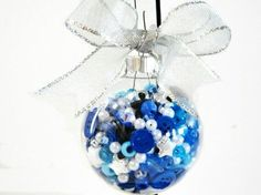 Fun to do with the kids. ..fill clear glass ornaments with different things...buttons beads ect