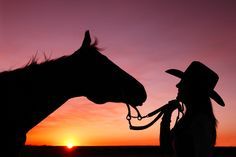 A cowgirl and her horse as the sun sets over Hill County, Montana.  Todd Klassey.