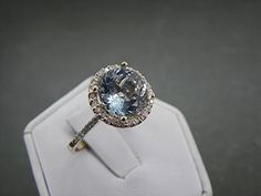 AAA Natural Untreated 10mm Round Aquamarine (3.81ct) set in 14K Yellow gold Halo ring with .50 carats of diamonds $1175 Etsy