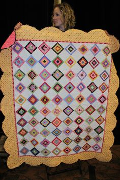 March 2013   American Quilting Retreat....good combinations of colours with the scalloped border