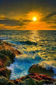 Waves breaking over Phuket, Thailand - sunset