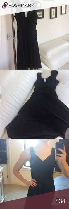 Might London black sleeveless rouched dress Might London black sleeveless rouched dress. Sexy and cute criss cross of material in front. Flowy bottom section perfect to twirl when you're out dancing. Slightly snug under my arms because of my thick shoulders from yoga. Only worn twice. Size 6 but fits like a 2-4. I'm a 34B. Fits perfectly around the chest but could fit on someone slightly smaller as well. Would be snug on any bigger size. Please let me know if you have any questions…
