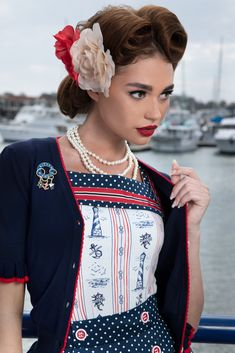 The Abandon Ship Cardigan is a cropped design and is ideal for layering with your favourite Abandon Ship designs. Navy in colour featuring a red trim and buttons The perfect classic addition to complete your Kitten look! Abandoned Ships, Women Accessories, Ruffle Blouse, Kitten, Classic, Red, Layering, Color, Buttons