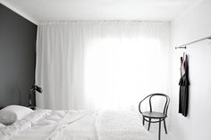 Dress a whole wall with curtains for hotel feel.