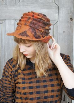 Unique spiral-shaped felted hat with brim  shades of by filcAlki