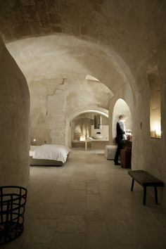 Room in the Hotel Corte San Pietro, located in Matera, one of the oldest and most unusual cities in Italy. This hotel is in a cave complex in Italy dating back to the century. Designed by architect Daniel Amoroso. Photo by PierMario Ruggeri. Interior Architecture, Interior And Exterior, Kitchen Interior, Modern Interior, Modern Decor, Cave City, Hotels And Resorts, House Design, Design Hotel
