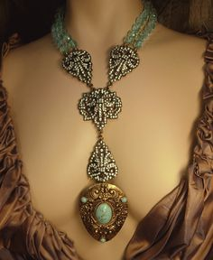 Statement necklace Heidi Daus pave rhinestones with victorian dress clip in Turquoise. $475.00, via Etsy.