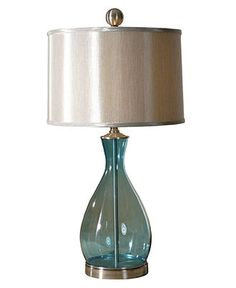 "$280 A stunning cool blue tone and just the right amount of shine make the Meena lamp from Uttermost simply irresistible. The shapely, mouth-blown glass base in translucent blue results in a lovely, sea glass effect. A silken gray hardback drum shade adds contemporary chic. 29""H 150W max Mouth-blown glass with satin nickel metal accents"