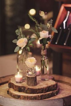 """R: We are using wooden slabs for table decor and small clear glasses and amber glasses as vases for single stemmed flowers and """"leftover"""" flowers"""