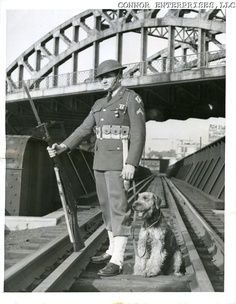 Soldier and sentry dog / Airedale Terrier. c. 1942