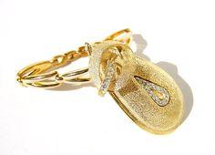 watch band bracelet embellished with vintage brooch
