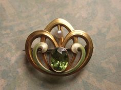 Art Nouveau Brooch 14 Karat Gold With Peridot And Seed Pearl By Bippart Griscom and Osborn Circa 1900