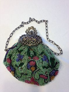Vintage bag with multi-colored flowers, metal frame and clasp