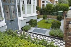 Small front garden, I love the black and white checked path.
