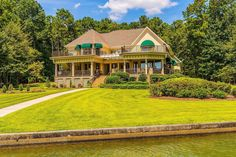 CLICK2TOUR elegant lake home, 4651SF,, 5BR/5.5BA, 2 living areas, deep covered porch overlooking lake, level lot w/ beach pier w/ lift, 3 car garage, workshop, safe room & more! For more details, call/text, Bill Yeatman, 205-835-2617, Century 21, Lake Area Realty. Photos & tour by Sherry Watkins…I Shoot Houses…http://www.Go2REassistant.com/VirtualTours.htm #LakeMartinAL #waterfronthomes