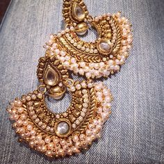 'Jodha' Earrings - made with an Antique gold finish and pearl details. Mughal…