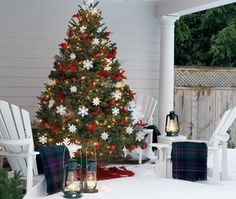 Dazzling Decorating Ideas For Your Amazing Christmas: Small Christmas Tree At Traditional Porch Decor With White Chairs ~ flohomedesign.com Decorating Inspiration
