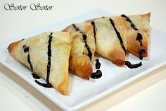 Triángulos de pasta brick rellenos de queso Gorgonzola, puerros y jamón york