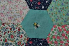 Patchwork quilt with bees