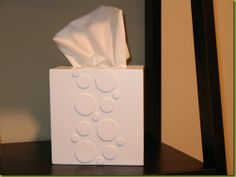 Make a tissue box cover! No matter how pretty tissue boxes are now, they never quite match the room they're in.