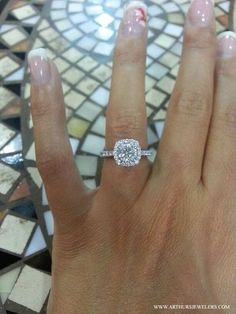 The Top Pinned Engagement Ring on Pinterest. A unique and simple halo diamond engagement from Tacori, exclusively available at Arthur's Jewelers. #haloring #engagementring #diamondring #uniquering #arthursjewelers