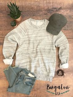 Our B123 Athluxe White Marble Sweatshirt is an unbelievably plush sweatshirt you will reach for time and again. Ribbed cuffs and waistband. Oversized fit. Cotton/Poly blend. Shown with the Harlowe Jea