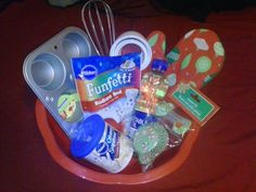 Cheap and simple gift basket! All items can be found at the dollar tree :) Mixing bowl, muffin pan, whisk, measuring cups, oven mitt, cake mix, vegetable oil, cupcake liners, and frosting :)