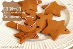 Making Cinnamon Applesauce Ornaments 1 cup applesauce 1 1/2 cups cinnamon Mix 1 cup applesauce and 1 cup cinnamon together.  Sprinkle counter with cinnamon.  Roll out dough and cut shapes.  Punch holes with straw. Bake at 175-200 degrees for 2 hours or more.