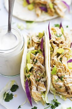 Slow Cooker Ranch Chicken Tacos: Slow cooked ranch chicken wrapped in soft flour tortillas and topped with red onion and cabbage slaw, cilantro, and creamy ranch dressing.   Creme de la Crumb#Tacos #Chicken #Slow_Cooker