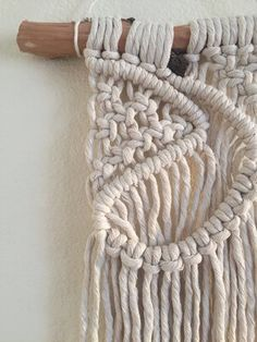 This macrame mini wall-hanging is hand-made by Hanifah Tohir in Sydney, Australia. It is a perfect piece to hang amongst other small artworks in a cluster on your wall whether it be in your bedroom, nursery, kitchen or living room.  Measurements:  Length: 18cm approx. Height: 30cm approx.
