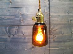Recycled Modelo Beer Bottle Pendant Light - Short Brown - Upcycled Industrial Glass Ceiling Light by VexDecor on Etsy https://www.etsy.com/listing/204615550/recycled-modelo-beer-bottle-pendant