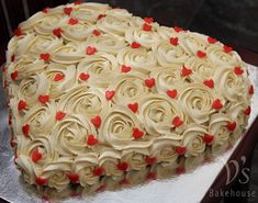Vanilla rosette heart cake frosted with fresh cream.