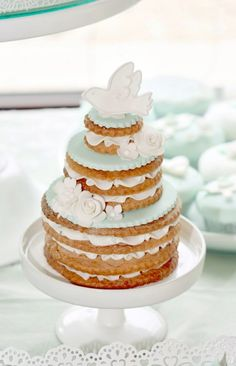 Such a pretty cake from this Mint and White Bird Themed Baptism Party with SUCH DARLING IDEAS via Kara's Party Ideas! full of decorating ideas, dessert, cake, cupcakes, ...