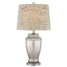 Table lamp with a glass base and shade with script details.   Product: Table lampConstruction Material: Metal and glassColor: Brushed nickel Features:  3 -Way switchContemporary style Accommodates: (1) 150 Watt A21 Medium base bulb - not includedDimensions: 26 H