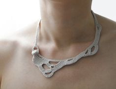 Freeform crochet necklace. great for a comfortable casual look. The crocheted fabric is well-suited for people with allergies who cannot tolerate metals. We love Okapiknits' incredibly unique designs                                                                                                                                                                                  More