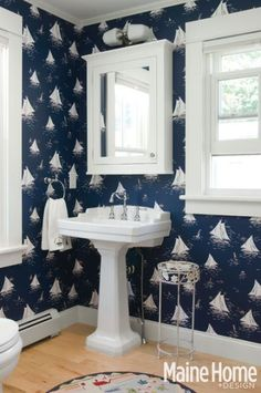 Cottage by the Sea, Cape Porpoise, ME - a little on the themey side, but I like the crisp Navy blue and white, and the vintage fixtures.
