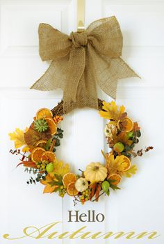 Filling a wreath with faux pumpkins and leaves is one thing           —  including cinnamon sticks, eucalyptus and oven dried oranges is quite another.  Get the tutorial at I Don't Know How She Does It »   - CountryLiving.com