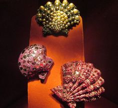 Three Seashell Brooches, Spinels, rubies, silver, gold; private collection, 1990. and Spinels, diamonds, silver, gold; private collection, 2009. Photo credit- Anthony DeMarco
