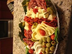 Easy Antipasto Platter - Fresh Mozzarella, Salami, Olives, Pepperoncini, Pepperoni, Provolone Cheese and Cherry tomatoes. So easy and so yummy!
