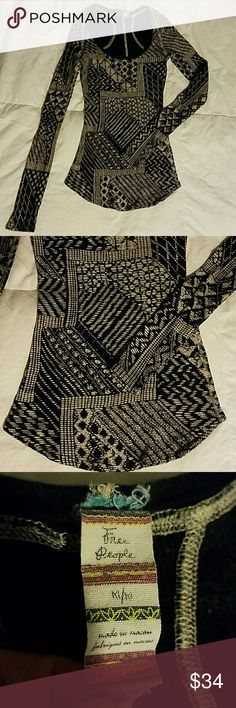 Free People Patterned Thermal Tee 100% Cotton Marked as a Medium; stretchy but fits more like a Small IMO  Stylish fitted thin thermal long sleeve tee from Free People. Amazing black and white allover print and cool contrast stitching on the back (see last photo)!  EUC Smoke free, pet friendly home Free People Tops Tees - Long Sleeve