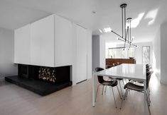 Immaculate white adds a lot of light in contrast with the black and walnut wood elements - CAANdesign | Architecture and home design blog